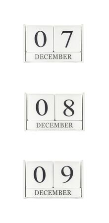 7 8: Closeup group of white wooden calendar with black 7 , 8 , 9 december  word , three date calendar isolated on white background