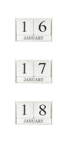 Closeup group of white wooden calendar with black 16 , 17 , 18 january word , three date calendar isolated on white background