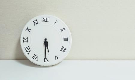 closeup white clock for decorate show half past five p m or stock
