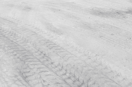dirty car: Closeup surface concrete floor with tire tracks textured background in black and white tone