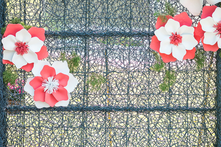 metal grate: Closeup metal frame with artificial flower for decorate in the garden textured background Stock Photo