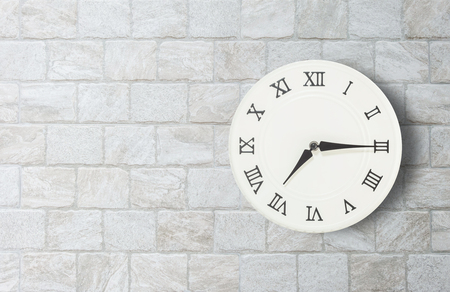 seven o'clock: Closeup white clock for decorate show a quarter past seven oclock or 7:15 a.m. on old brick wall textured background with copy space in interior concept Stock Photo