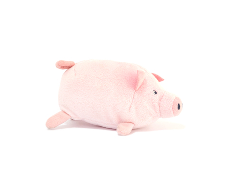 Closeup cute pink pig doll isolated on white background