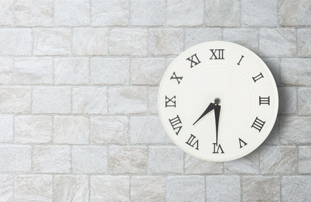 seven o'clock: Closeup white clock for decorate show half past seven oclock or 7:30 a.m. on old brick wall textured background with copy space in interior concept