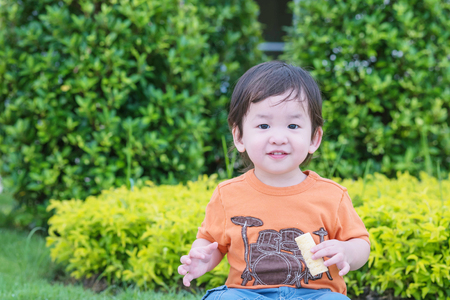 puerile: Closeup cute asian kid play in the park background