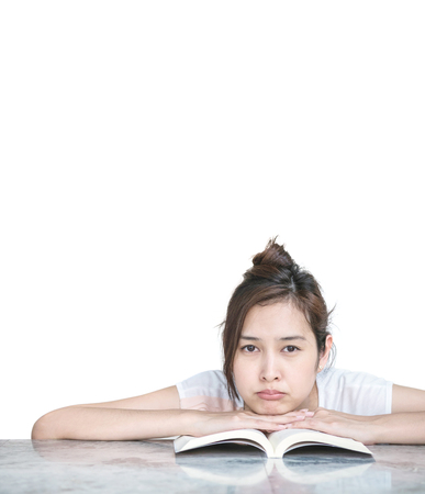 balcony: Closeup asian woman with boring face with a book on marble table in front of house isolated on white background with copy space