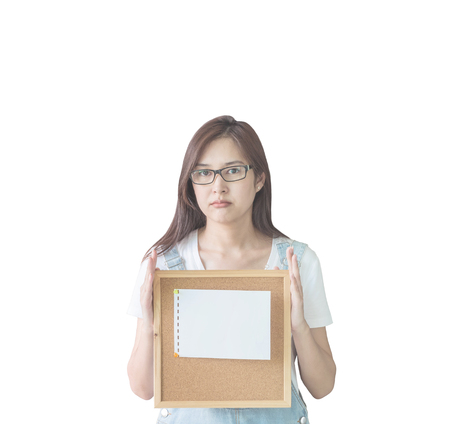Closeup asian woman with cork board in hand with boring face isolated on white background Stock Photo