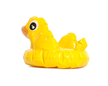 Closeup yellow duck inflatable doll isolated on white background Stock Photo