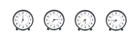 Closeup group of black and white clock for decoration show the time in 7 , 7:15 , 7:30 , 7:45 a.m. isolated on white background Standard-Bild