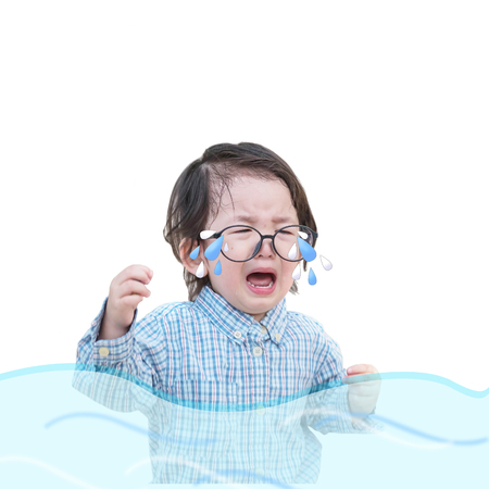 Closeup sad asian kid cry because he want something isolated on white background Stock Photo