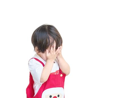 Closeup asian kid use their hands to close their eyes isolated on white background