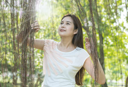 Woman stand in the garden with freshness emotion in the morning