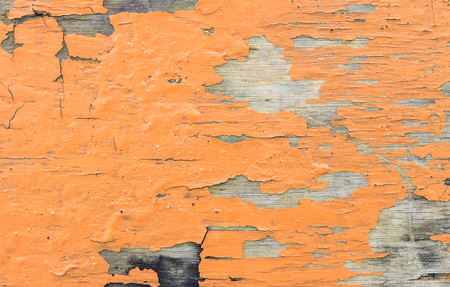 Closeup old and peeling painted wood board background Standard-Bild