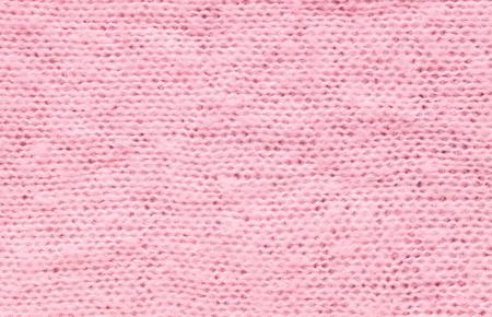 Closeup wrinkled pink coat fabric background