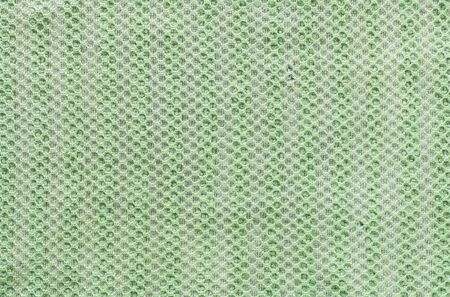 Closeup old and dirty green napkin fabric background