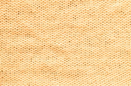 Closeup wrinkled orange coat fabric background Stock fotó