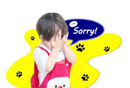 Closeup cute asian kid put his hand in front of him with I'm sorry word in text box isolated on white background Stock Photo