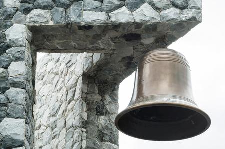 Closeup brass bell at the corner of the building 版權商用圖片