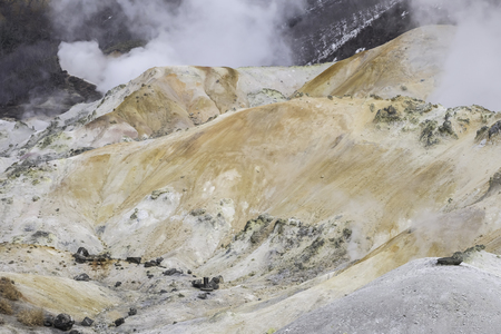 Landscape of mountain in the hot spring area with some smoke Standard-Bild - 122498147