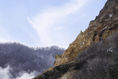 Landscape of mountain in the hot spring area with some steam on blue sky background Standard-Bild - 122498151