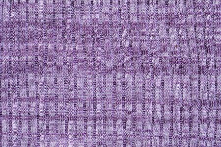 Closeup abstract pattern at purple womens clothing textured background