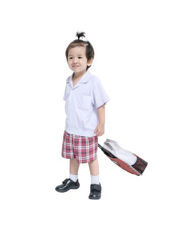 Closeup a little kid in student uniform with schoolbag isolated on white background Stock fotó