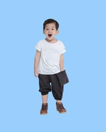 Closeup asian boy in happy emotion isolated on blue background