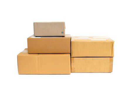 Closeup pile of parcel box isolated on white background Stock fotó