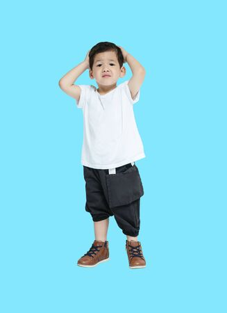 Closeup asian kid in disappointed feel isolated on blue background Stock fotó