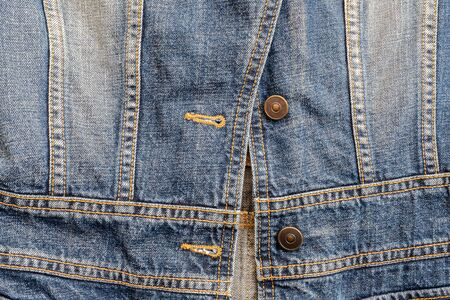 Closeup surface old jean jacket textured background Stock fotó