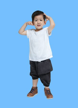 Closeup asian kid do not look satisfied with something isolated on blue background