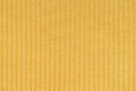 Closeup abstract pattern at yellow womens clothing textured background Stock fotó