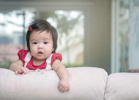Closeup cute baby girl on sofa with copy space Standard-Bild