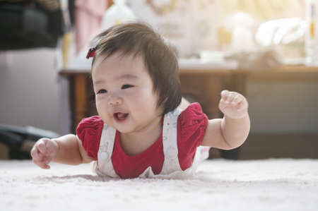 Closeup cute baby girl in funny motion