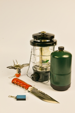 camping acessories compose with lantern, gas stove,bowie knife and lighter  photo