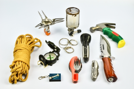 life rope,waterproof lighter,spoon and fork,pocketknife,bowie knife,compass,wire saw,multi tools flashlight,hammer,lantern,gas stove photo