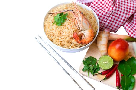 Close up Thai mama noodles instant food in white bowl and chopsticks. on White background. with copy space