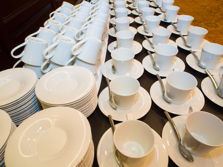 serve: Coffee cups lined up waiting to serve Stock Photo