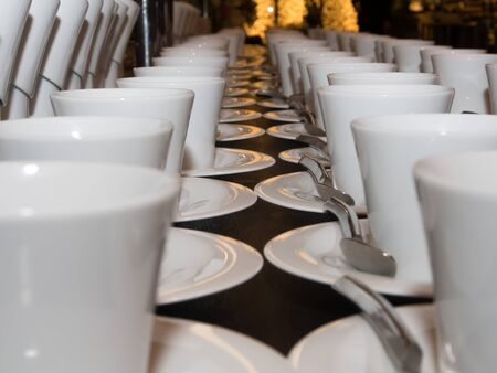 lined: Coffee cups lined up waiting to serve Stock Photo