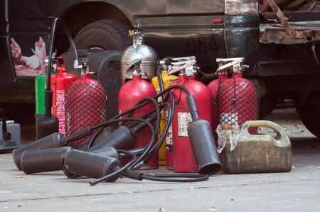 extinguishers: Fire extinguishers (Chemical Powder, Dry)-Being used Stock Photo