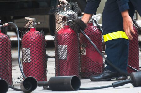 Fire extinguishers (Chemical Powder, Dry)-Being used Stock Photo