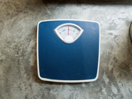 analog weight scale: Outdoor  scales to monitor body weight. Stock Photo