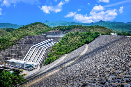 dyke: Rockfill dam of clay core in Thailand. Stock Photo