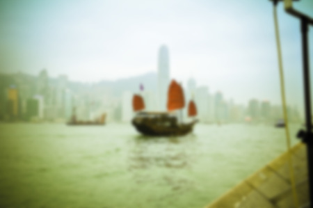 out of focus: Junks floating in the middle of Hong Kong harbor. Abtract blur, out focus, Nearsightedness is not clear. Stock Photo