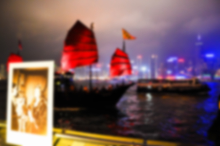 Junks floating in the middle of Hong Kong harbor. Abtract blur, out focus, Nearsightedness is not clear. Stock Photo