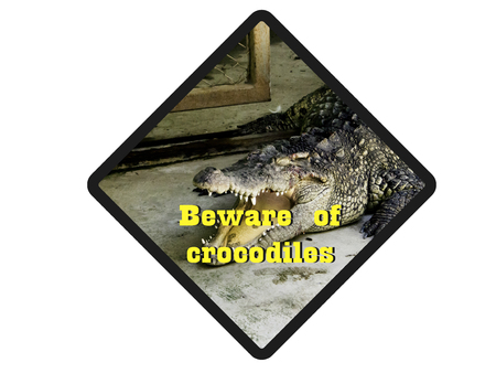 watch out: Beware ofcrocodiles. Warning signs to watch out for crocodiles.