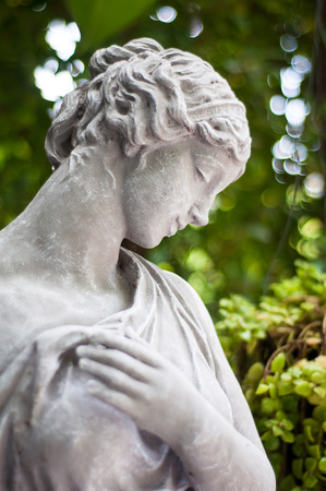 Gray plaster statue The garden is decorated in European style vintage  statue Girl