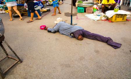 beggar's: Beggars legs crawling, begging in the market.