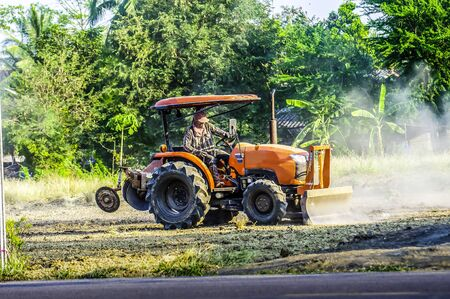 Tractor are plowing to adjust the area for football field and parking. Stock Photo