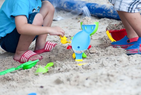 Kids on white sand Sandbox And antimony of children playPractice your childs muscular and imaginative skills.